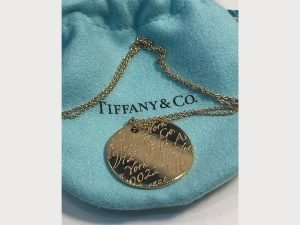 tiffany and co 18k gold large notes necklace on 18 chain front